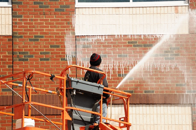 Schedule Pressure Washing to Protect Your Exterior Walls from Organic Growth